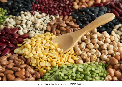 Grains seed soybeans on wooden spoon with various of legumes