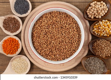 Grains and seeds variety - healthy and diverse food concept, with bowl of buckwheat in the center
