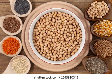 Grains and seeds variety - healthy and diverse food concept, with bowl of chickpea in the center