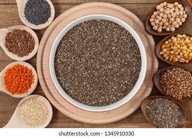 Grains and seeds variety - healthy food concept, with bowl of chia in the center