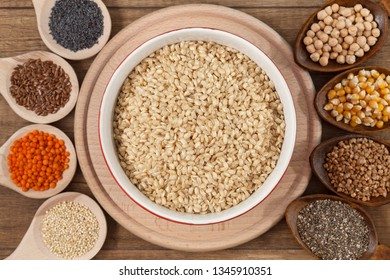 Grains and seeds variety - healthy food concept, with bowl of rice in the center