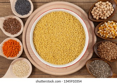 Grains and seeds variety - healthy food concept, with bowl of millet in the center
