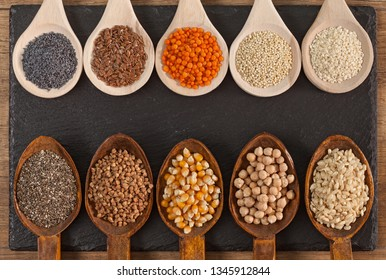 Grains and seeds variety in wooden spoons - healthy and diverse plant based food concept, top view