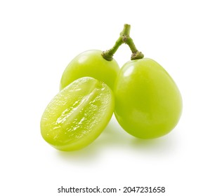 Grains of shine muscat grapes and cut shine muscat grapes on a white background. White grapes.  Japanese grapes.