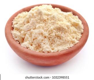 Gram flour in bowl over white background