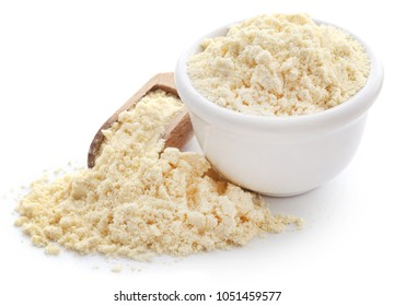 Gram flour in bowl and wooden scoop over white background