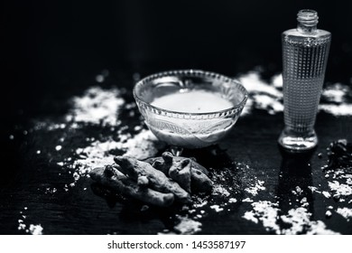 Gram flour or chickpea flour well mixed with turmeric using rose water in a glass bowl and making gram flour face mask for maintaining the pH of the skin.