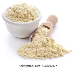 Gram flour closeup over white background