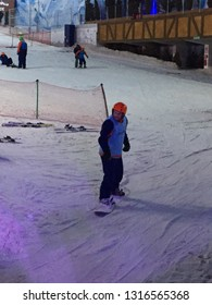 Gramado, Brazil, February 11, 2019: Snowland in Gramado. A young man descending from snowboard: a sport that consists of descending with a board on slopes covered with snow.