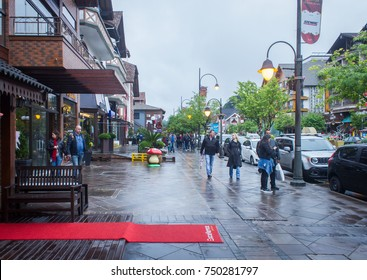 GRAMADO, BRAZIL - November 04, 2017 - Tourists walking on a cloudy day in the streets of downtown Gramado, Rio Grande do Sul, Brazil