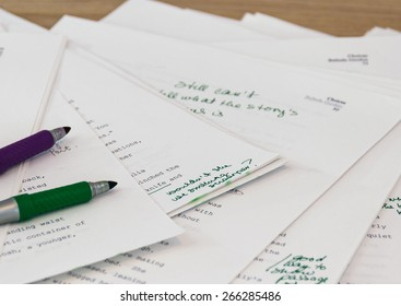grammar being corrected on manuscript sheets