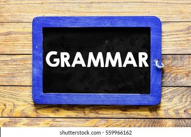 Grammar / Blackboard chalk inscription grammar on wood.
