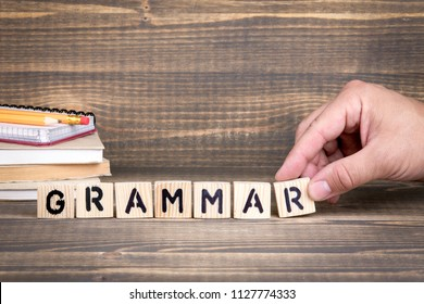 grammar. Language, knowledge and self-education concept. Wooden letters on the office desk, informative and communication background
