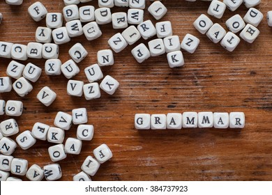 grammar, learn language concept, word from wooden letters