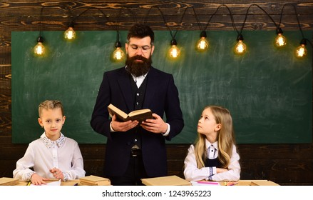 grammar. school lesson of grammar subject. grammar lesson for two small girls with serious teacher man. literature and grammar