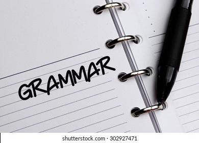 GRAMMAR word written on notebook