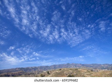 Gran Canaria, beautiful cirrus clouds over Montana Bermejal, Las Cumbres in far distance