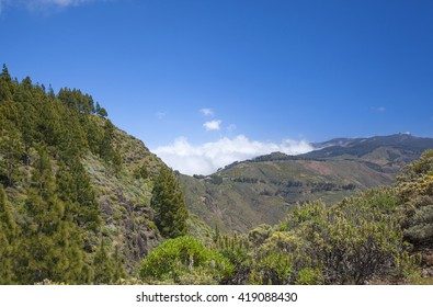 Gran Canaria, Caldera de Tejeda in May, clouds accumulate at mountain pass Cruz de Tejeda