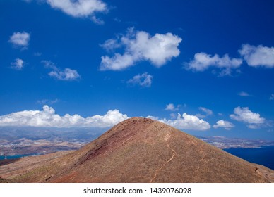 Gran Canaria, Canary Islands, image taken  from La Isleta peninsula, Montana las Coloradas in the foreground, natural background of predominantly sky