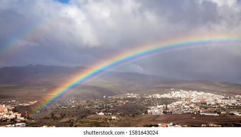 Gran Canaria, December, rainbow over  towns Aguimes and Ingenio