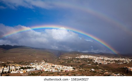 Gran Canaria, December, rainbow over  towns Aguimes and Ingenio, ravine Barranco de Guayadeque between two towns