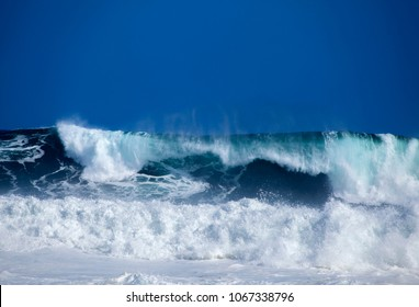 Gran Canaria, foamy waves breaking by the shore in Banaderos area