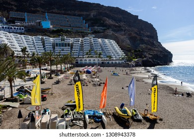 Gran Canaria, January 30, 2019 - People enjoying the sun at the sandy beach of the tropical village of Taurito in Gran Canaria