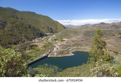 Gran Canaria,  July, hiking through nature reserve Tamadaba, view towards Agaete valley,  water reservoirs