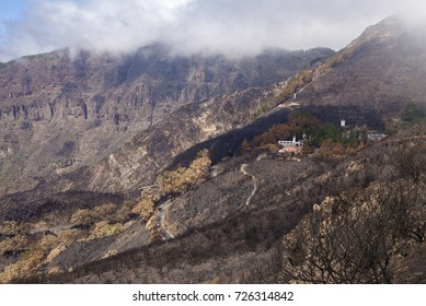Gran Canaria, Las Cumbres, the highest areas of the island, after forest fire of september 2017, view towards untouched front of Parador National de Cruz de Tejeda, destroyed by fire