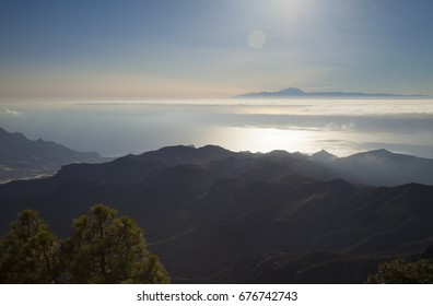 Gran Canaria,  late afternoon light over Teide on Tenerife, the peak of Teide  over the layer of clouds, ocean below, view from Altavista montain, aboriginal name Azaenegue