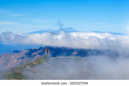 Gran Canaria, March 2018, Las Cumbres - the highest areas of the island, view towards Teide on Tenerife above cloud blanket, Roque Bentayga rock formation below