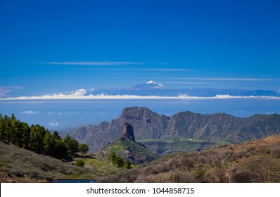 Gran Canaria, March 2018,  view along a small valley, Roque Bentayga, Altavista and Teide on Tenerife lined up