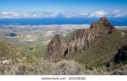 Gran Canaria, March, view from a hiking path in Valsequillo municipality towards villages, over rock formation Roques Tenteniguada