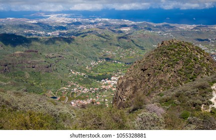 Gran Canaria, March, view from a hiking path in Valsequillo municipality towards villages, rock formation Roque Del Pino to the right