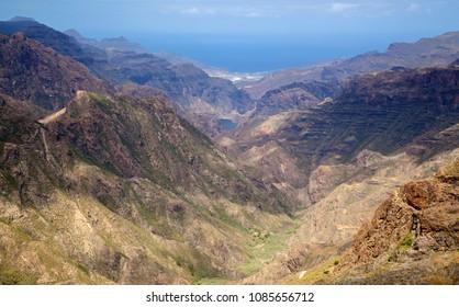 Gran Canaria, May, montains of the central part of the island, view down the valley Barranco de Tejeda, La Aldea de San Nicolas in far distance