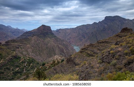 Gran Canaria, May, montains of the central part of the island, valley Barranco de Carrizal, reservoir Presa de Parralillo in the distance