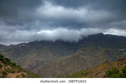 Gran Canaria, May, montains of the central part of the island, view across Caldera de Tejeda, clouds falling into the caldera over its lip