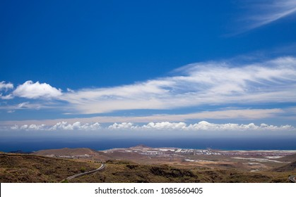 Gran Canaria, May, view towards ocean from hiking path Temisas - Aguimes, different types of clouds over ocean