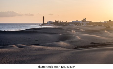 Gran Canaria sand dunes in Maspalomas with lighthouse in the background during the sunset