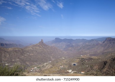 Gran Canaria, September, calima,  dusty air brought by prevailing winds from Africa, blankets the island, Teide on Tenerife raises over it, some anticrepuscular rays visible