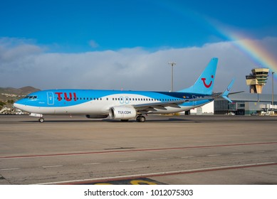 GRAN CANARIA / SPAIN - JANUARY 2018 TUI Airlines Belgium Boeing 737-8K5(WL) OO-JEF, cn  44271/4805 taxing fot departure in front of a beutiful rainbow.