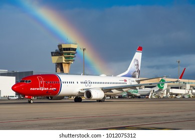 GRAN CANARIA / SPAIN - JANUARY 2018 Norwegian Air International Boeing 737-8JP(WL) EI-GBF, cn 39022/4528 displaying a portrait of norwegian writer Johan Falkberget in front of a beautiful rainbow.
