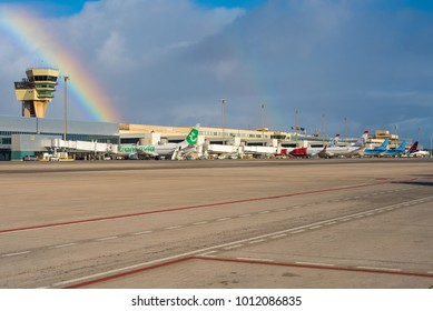 GRAN CANARIA / SPAIN - JANUARY 2018 Busy airport scene on a winterday at Las Palmas Airport (GCLP) with 6 planes being handeled at the time under a beautiful rainbow.
