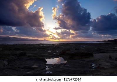 Gran Canaria, sunset at El Confital beach at the edge of Las Palmas, the capital of the island
