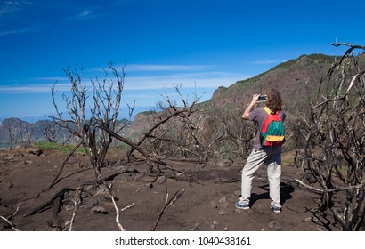 Gran Canaria, tourist is taking pictures around Cruz de Tejeda, area burned by forest fire