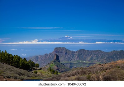 Gran Canaria,  view along a small valley, Roque Bentayga, Altavista and Teide on Tenerife lined up