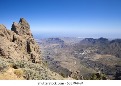 Gran Canaria, view from Pico de Las Nieves towards valley Barranco de Tirajana,  rock formation Morron de Agujerada