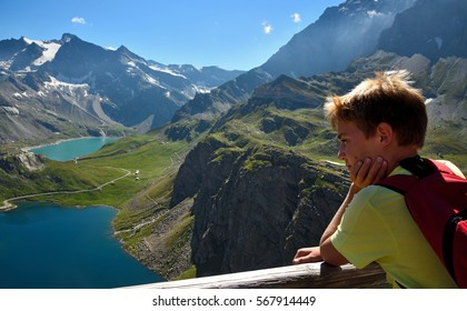Gran Paradiso Nation Park - From the Nivolet Pass (Col del Nivolet) in the Orco Valley, a kids is looking haed Ceresole Reale