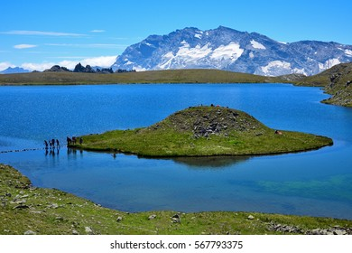 Gran Paradiso Nation Park - Rosset Lake at 2700mt altitude with an island. Nivolet Pass (Col del Nivolet) in the Orco Valley, Ceresole Reale.