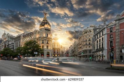 Gran Via shopping street in Madrid, Spain, during sunset